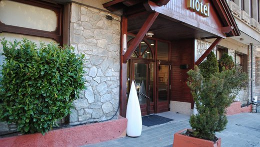 A rustic entrance, typical of mountain hotels